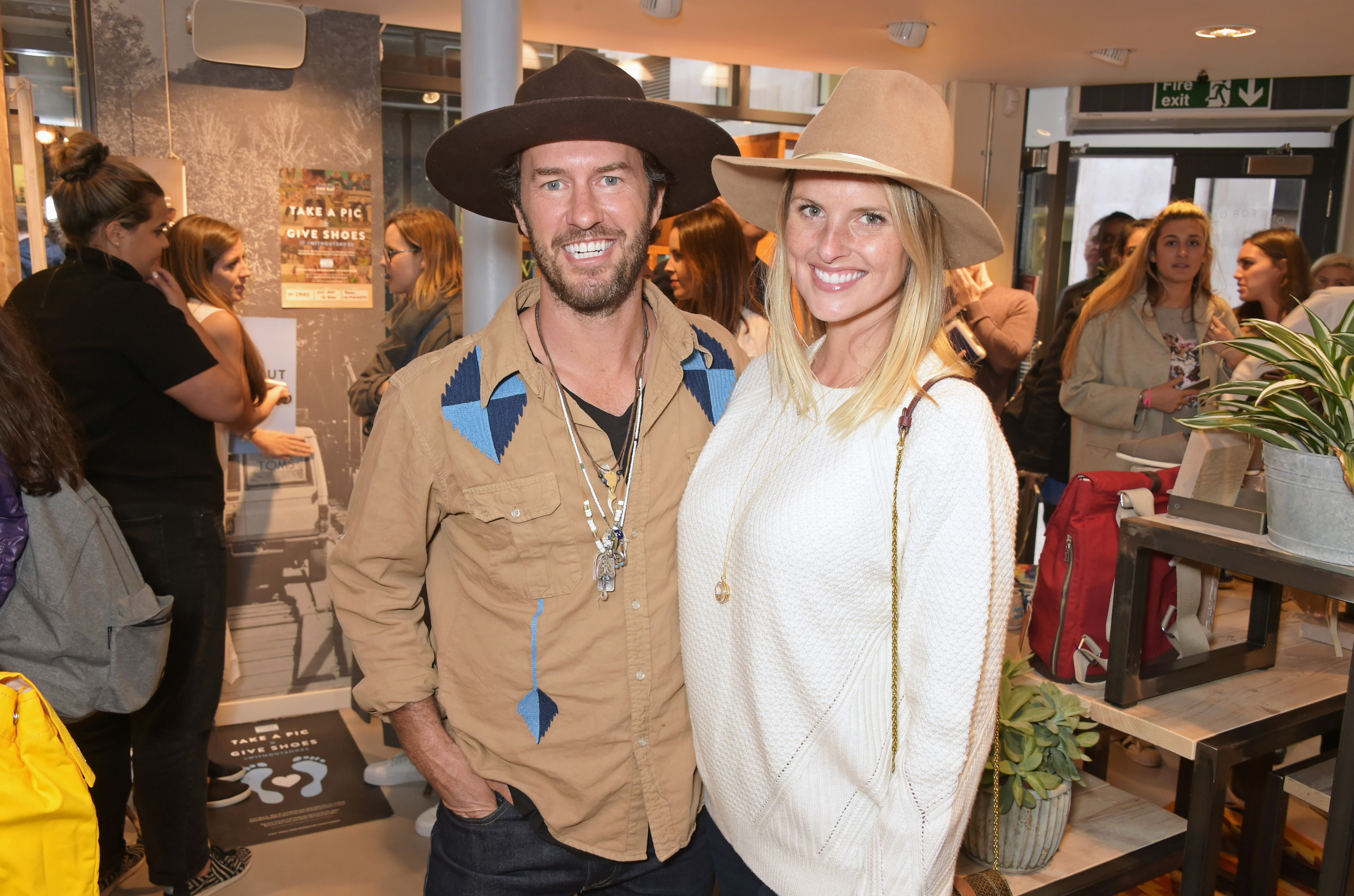 LONDON, ENGLAND - MAY 05: TOMS founder Blake Mycoskie (L) and wife Heather Mycoskie attend the launch of TOMS London Community Outpost, their first UK Flagship store off Carnaby Street on May 5, 2015 in London, England. Pic Credit: Dave Benett